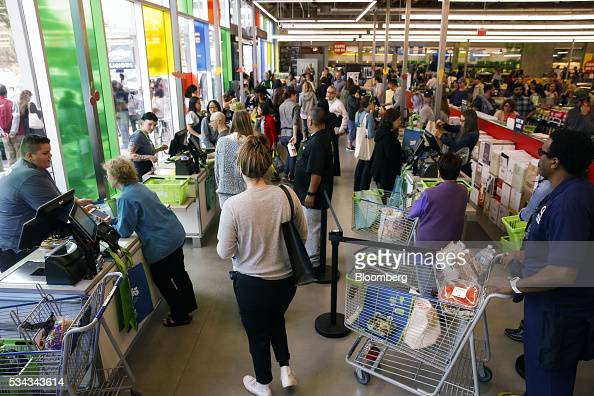 Customers wait in line to check out on the opening day of the 365 by Whole Foods Market store in the Silver Lake neighborhood of Los Angeles...