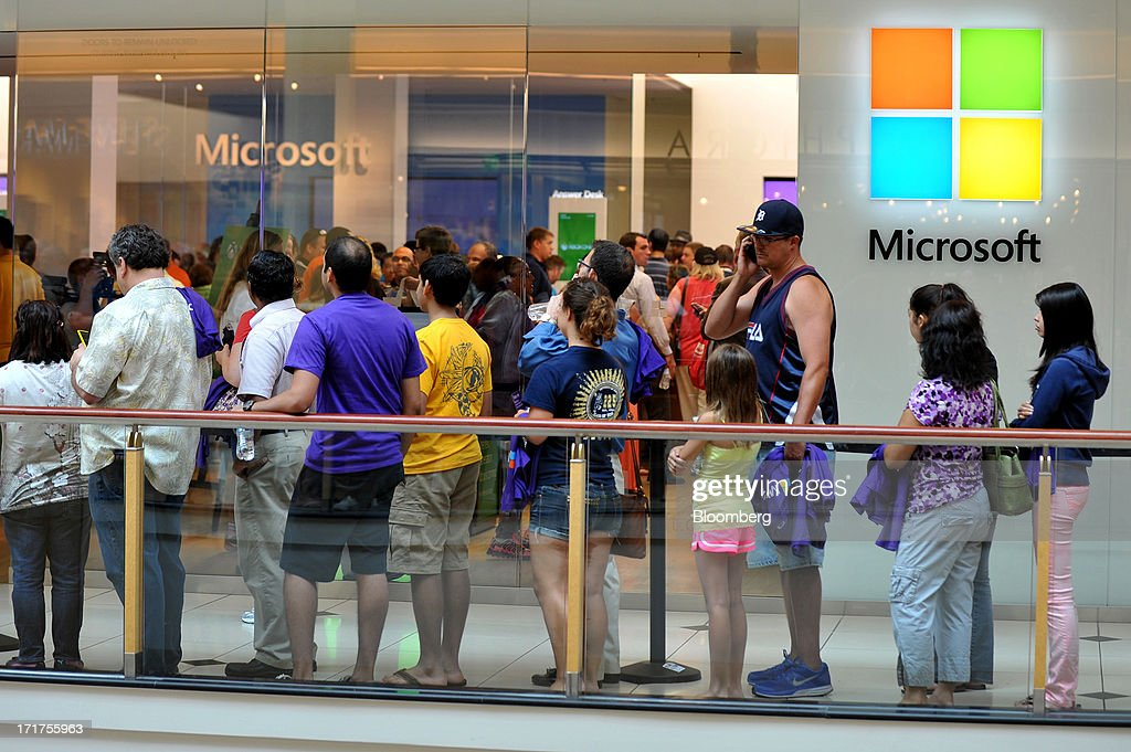 Customers wait in line to enter a Microsoft Corp. store during the grand opening in Troy, Michigan, U.S., on, Friday, June 28, 2013. Microsoft, which has been struggling with the inability of outside retailers to effectively display its products, aims to generate more enthusiasm for them by opening its own stores. Photographer: Bryan Mitchell/Bloomberg via Getty Images