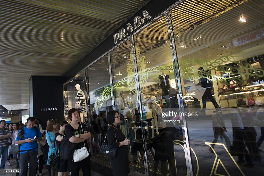 Customers wait in line to enter a Prada SpA store in the Tsim Sha Tsui area of Hong Kong, China, on Tuesday, April 30, 2013. Financial Secretary John Tsang on Feb. 27 projected annual growth of 1.5 percent to 3.5 percent this year following 2012's 1.4 percent, the weakest rate since 2009 as Europe's sovereign debt crisis sapped global demand. Photographer: Lam Yik Fei/Bloomberg via Getty Images
