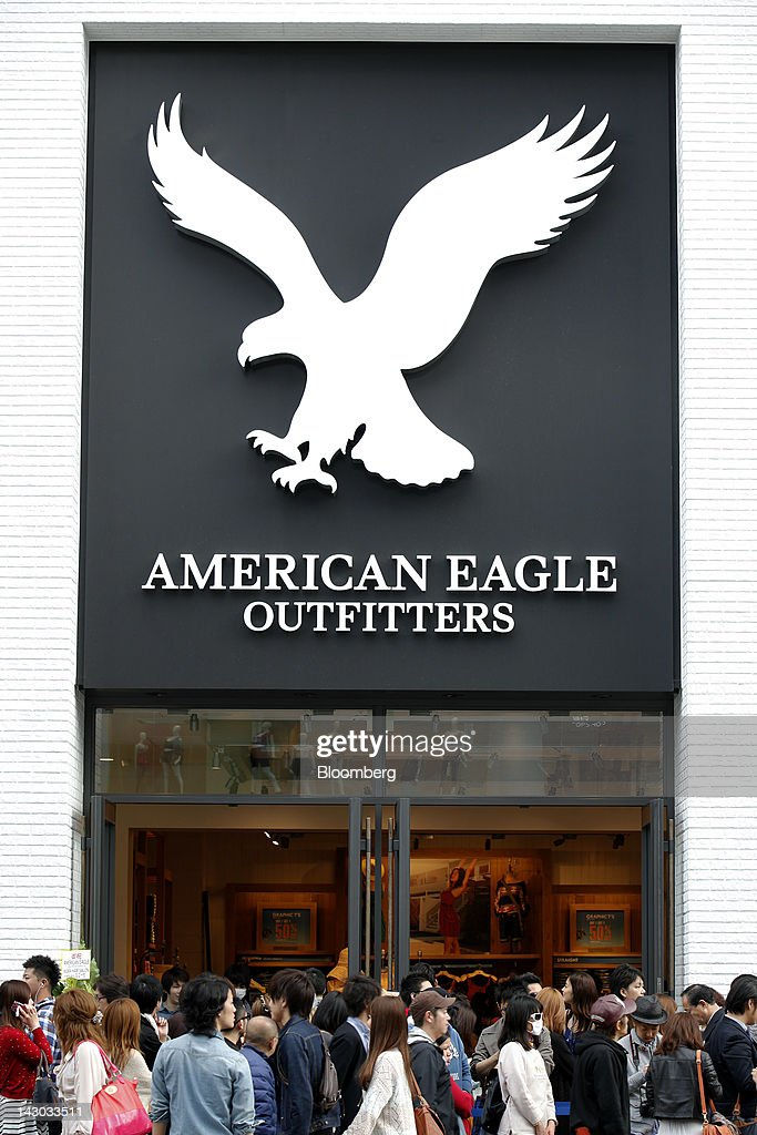 Customers wait in line to enter an American Eagle Outfitters Inc. store in Tokyo, Japan, on Wednesday, April 18, 2012. American Eagle Outfitters Inc., a retailer of men's and women's casual apparel, opened its first store in Japan inside the Tokyu Plaza Omotesando Harajuku retail complex in the Omotesando district of Tokyo today. Photographer: Kiyoshi Ota/Bloomberg via Getty Images