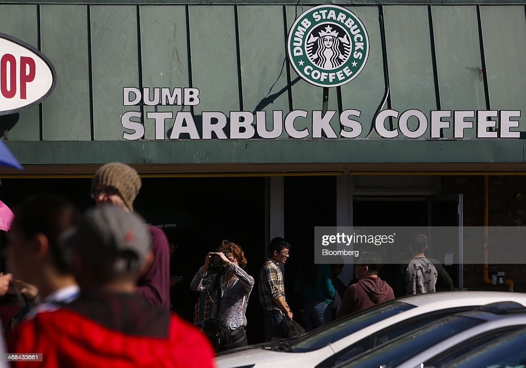 Customers wait in line to enter the Dumb Starbucks Coffee store, a parody of the Starbucks Corp. coffee chain, in Los Angeles, California, U.S., on Monday, Feb. 10, 2014. Dumb Starbucks, which opened this past weekend, offered Dumb Vanilla Blonde Roast, Dumb Chai Tea Latte, and Dumb Caramel Macchiato, all available in sizes Dumb Venti, Dumb Grande, and Dumb Tall. Photographer: Patrick T. Fallon/Bloomberg via Getty Images