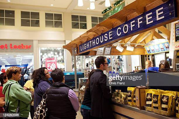 Customers wait in line to order coffee at the West Acres Mall on November 25 2011 in Fargo North Dakota Over 30 stores at the West Acres Mall opened...