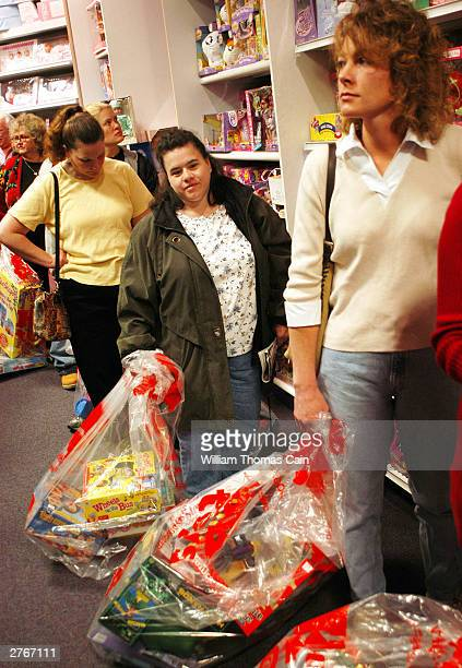Customers wait in line to pay for their items while doing their Black Friday shopping at KB Toys which opened at 5am in the King of Prussia Mall...
