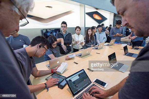 Customers wait in line to purchase new Apple Inc iPhone 6s smartphones at an Apple store in Palo Alto California US on Friday Sept 25 2015 From...