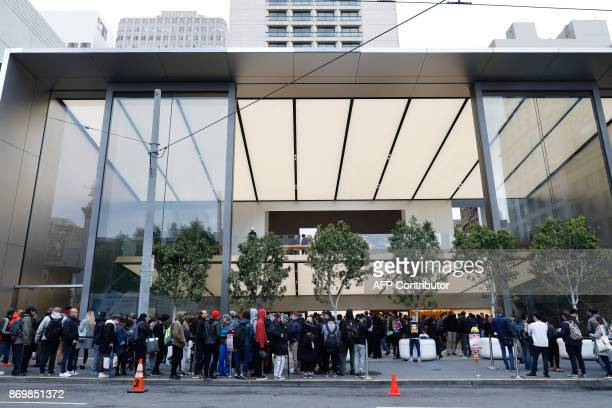 Customers wait in line to purchase the new iPhone X at the Apple Store Union Square on November 3 in San Francisco California Apple's flagship iPhone...