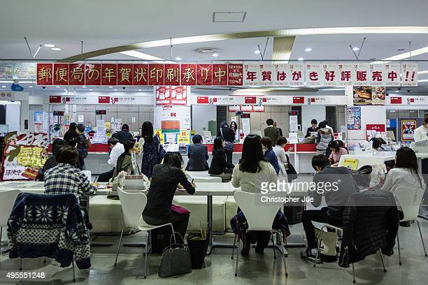 Customers wait to be called by a Japan Post Co employee at a busy Japan Post Co office in downtown Tokyo on November 4 2015 in Tokyo Japan Shares in...