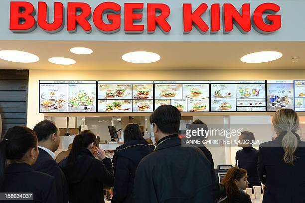 Customers wait to be served at the Burger King fast food restaurant in Marseille's airport in Marignane southern France on December 22 2012...