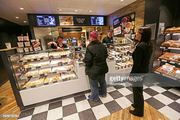 Customers wait to be severed at the counter in a Greggs Plc sandwich chain outlet in Caterham UK on Thursday Oct 22 2015 Samestore sales at Greggs...