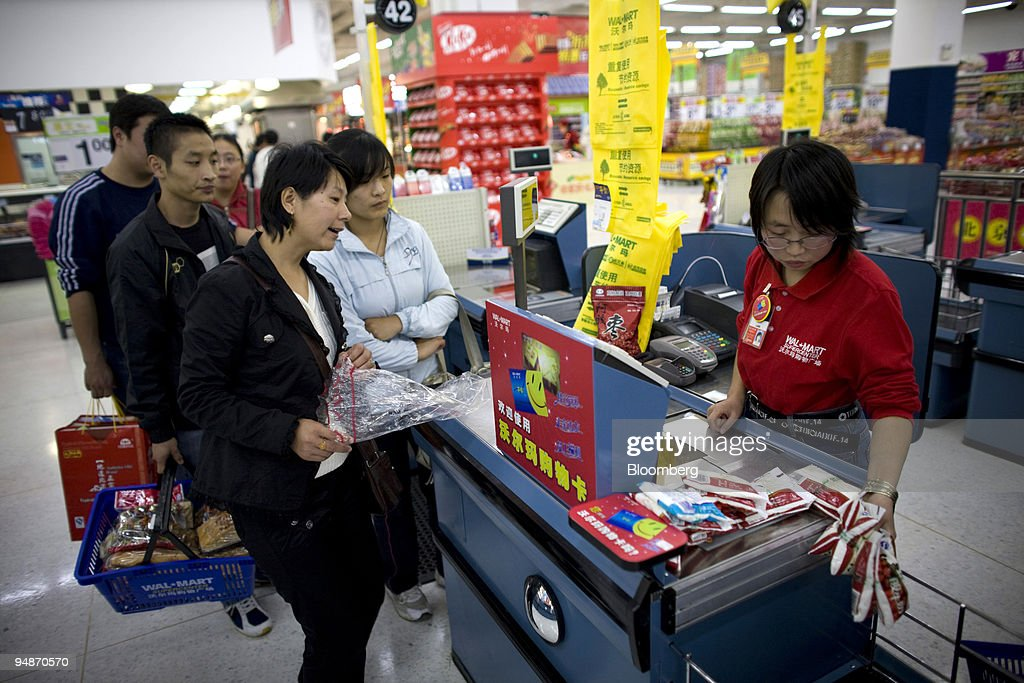 Customers wait to check out at a WalMart Stores Inc outlet in Beijing China on Tuesday Oct 21 2008 WalMart Stores Inc Carrefour SA and other overseas...