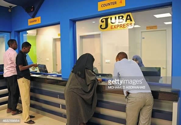 Customers wait to collect money at the Juba Express money transfer company in Mogadishu on February 12 2015 The USbased Merchants Bank of California...