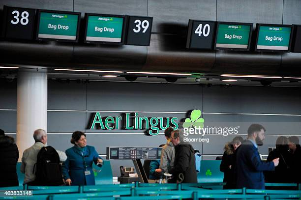 Customers wait to drop their luggage at the Aer Lingus Group Plc checkin desks in the departure hall at Dublin Airport operated by Dublin Airport...
