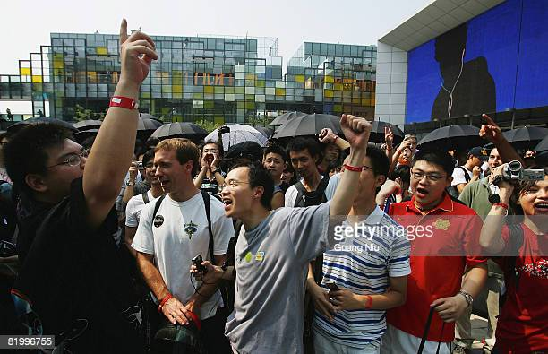 Customers wait to enter the first Apple store on July 19 2008 in Beijing China The twolevel store store sits at Beijing's Sanlitun entertainment...