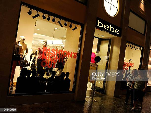 Customers walk by a Bebe store during Fashion's Night Out at The Forum Shops at Caesars on September 8 2011 in Las Vegas Nevada