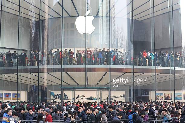 Customers walk in a newopened Apple Store as Nanjing opens second Apple Store on January 16 2016 in Nanjing Jiangsu Province of China Apple Inc has...