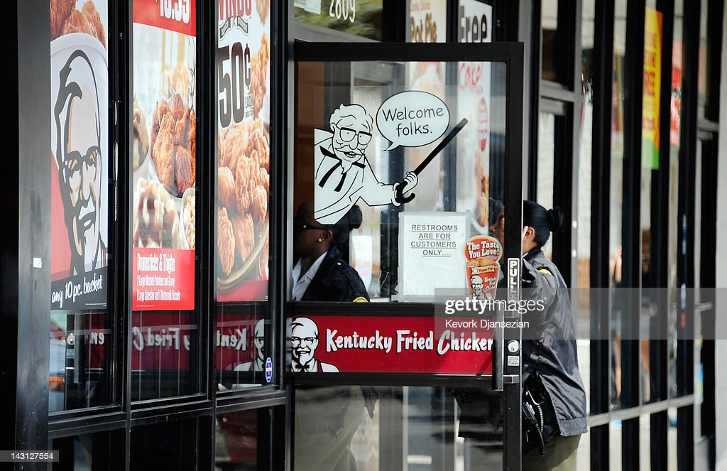 Customers walk in to a KFC restaurant during lunchtime April 19 2012 in Los Angeles California Yum Brands Inc the parent company of KFC Taco Bell and...