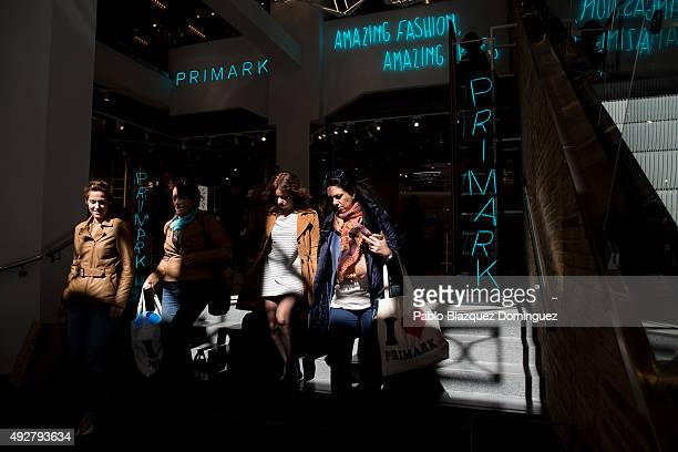 Customers walk inside Madrid Gran Via Primark store during the inaguration day on October 15 2015 in Madrid Spain Primark opened today the largest...