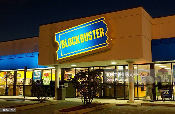 Customers walk into a Blockbuster Video store on November 19 2002 in the Little Havana section of Miami Florida Blockbuster is targeting the growing...