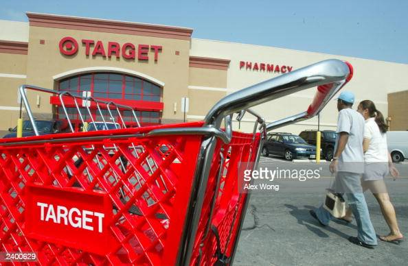 Customers walk outside a Target store August 14 2003 in Springfield Virgina Target Corp reported a four percent increase in secondquarter profits