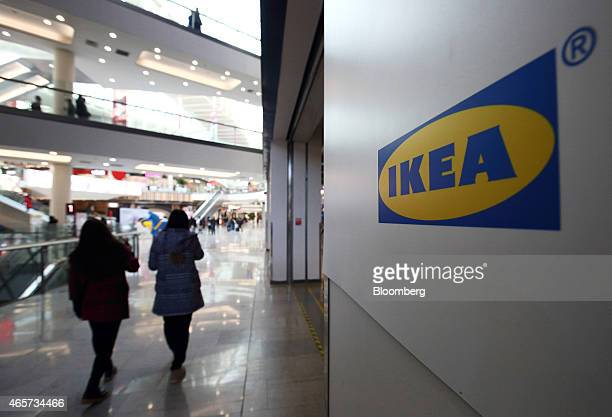 Customers walk past an Ikea logo at the Ikea Beijing Xihongmen Store operated by Ikea AB in Beijing China on Monday March 9 2015 China's consumer...