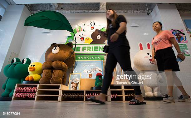 Customers walk past characters from the Line messaging app as they shop inside Line Corp's LINE Friends Harajuku store on July 11 2016 in Tokyo Japan...