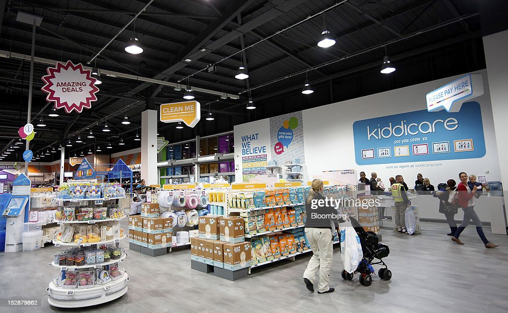 Customers walk through a Kiddicare Ltd. store, operated by WM Morrison Supermarkets Plc, in Nottingham, U.K., on Wednesday, Sept. 26, 2012. An index of U.K. retail sales rose for the first time in three months in September and stores expect demand to increase further next month, the Confederation of British Industry said. Photographer: Paul Thomas/Bloomberg via Getty Images