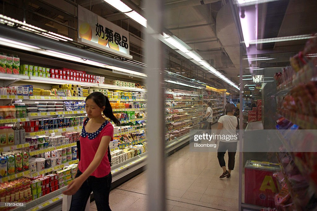 Customers walk through a refrigerated aisle of a ParknShop Superstore supermarket, operated by Hutchison Whampoa Ltd., in Hong Kong, China, on Thursday, Aug. 1, 2013. KKR & Co., the private-equity firm run by Henry Kravis and George Roberts, is evaluating a bid for Hong Kong supermarket chain ParknShop, according to two people with knowledge of the matter. Hutchison is seeking $3 billion to $4 billion for the chain and has asked potential buyers to submit bids by Aug. 16, people with knowledge of the process have said. Photographer: Lam Yik Fei/Bloomberg via Getty Images