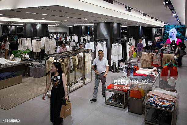 Customers walk through a Zara store operated by Inditex SA in Hong Kong China on Tuesday June 24 2014 Inditex which has increased profit every year...