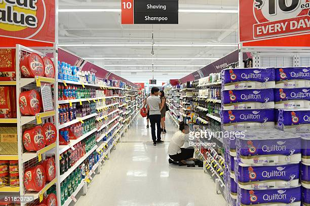 Customers walk through an aisle in a Coles supermarket operated by Wesfarmers Ltd in Melbourne Australia on Tuesday Feb 23 2016 Wesfarmers...