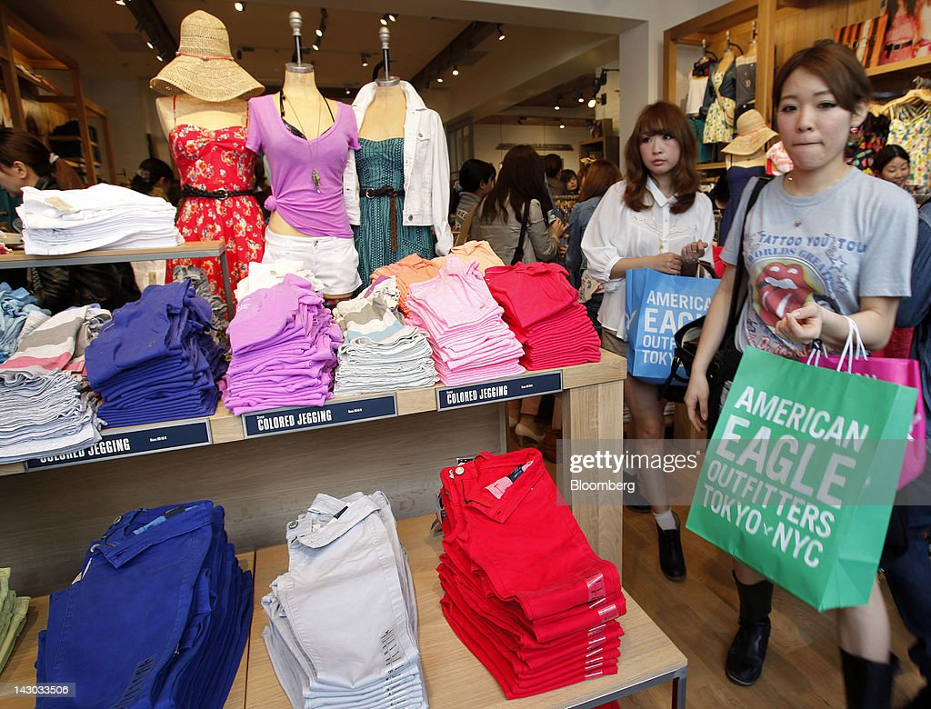 Customers walk through an American Eagle Outfitters Inc. store in Tokyo, Japan, on Wednesday, April 18, 2012. American Eagle Outfitters Inc., a retailer of men's and women's casual apparel, opened its first store in Japan inside the Tokyu Plaza Omotesando Harajuku retail complex in the Omotesando district of Tokyo today. Photographer: Kiyoshi Ota/Bloomberg via Getty Images