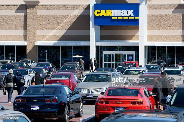 Customers walk through the sales lot at a CarMax Inc dealership in Brandywine Maryland US on Sunday March 29 2015 CarMax Inc is expected to release...