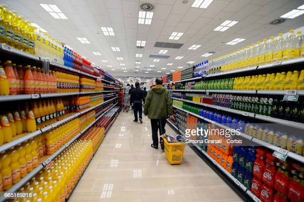 Customers walk through the soft drinks section as Italian supermarket chain Esselunga opens its first store in Rome in Via Palmiro Togliatti on April...