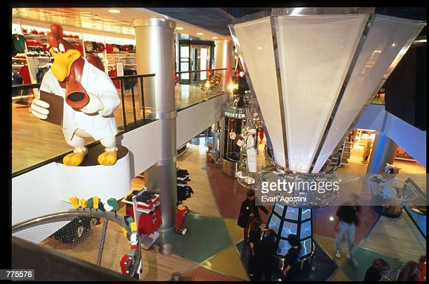 Customers walk through the Wacky ACME Interactive area of the Warner Bros Studio store October 23 1996 in New York City The store originally a three...