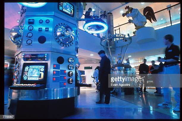 Customers walk through the Wacky ACME labs of the Warner Bros Studio store October 23 1996 in New York City The store originally a three floor...