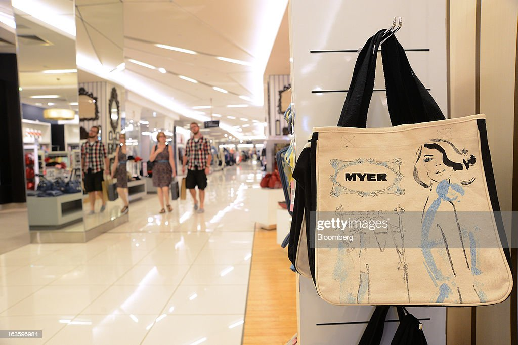 Customers walk through the women's clothing department at Myer Holdings Ltd.'s Melbourne City store in Melbourne, Australia, on Wednesday, March 13, 2013. Myer is scheduled to release company results on March 14. Photographer: Carla Gottgens/Bloomberg via Getty Images