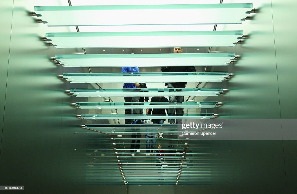 Customers walk up a staircase to purchase an iPad at the Apple store on George Street on May 28, 2010 in Sydney, Australia. Apple's new tablet media device went on sale in nine countries around the world today following its launch in the United States in April this year.