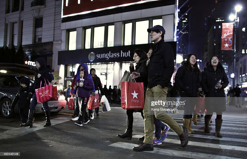 Customers walks outside Macy's Herald Square after the store opened its doors at 8 pm Thanksgiving day on November 28, 2013 in New York City. Black Friday shopping began early again this year with most major retailers opening their doors on Thanksgiving day.