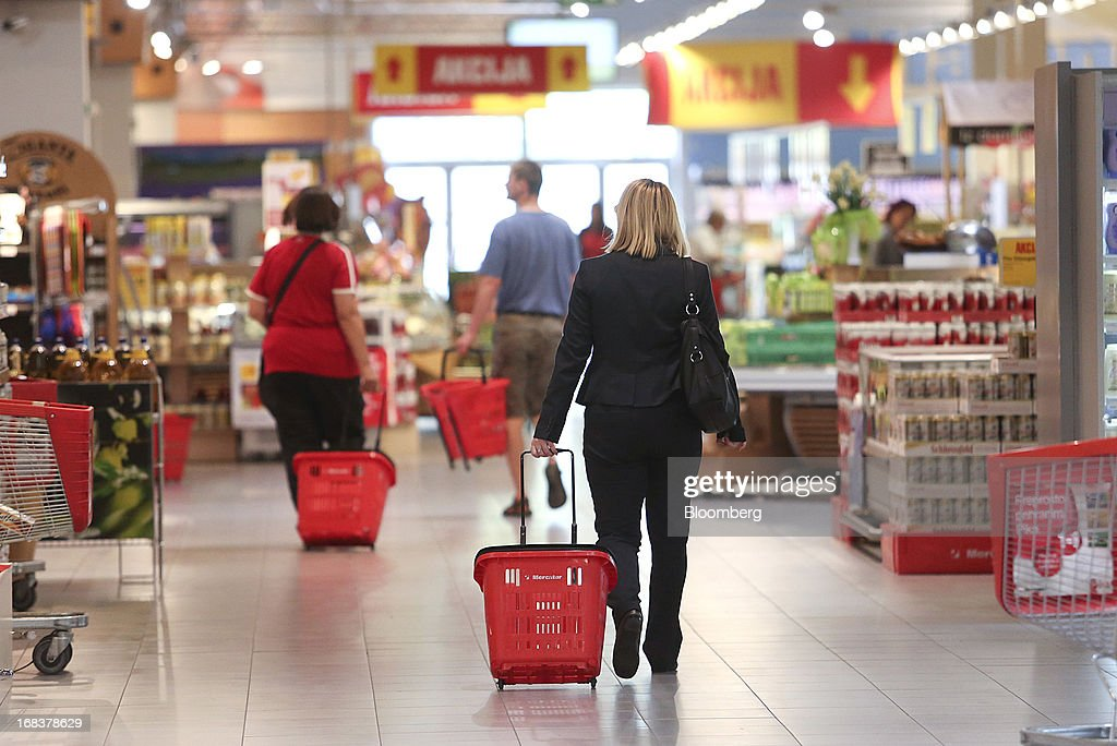 Customers wheel shopping carts past aisles inside a Mercator Poslovni Sistem d.d. supermarket in Ljubljana, Slovenia, on Wednesday, May 8, 2013. In January Mercator reported its first full-year loss in fifteen years as the largest supermarket chain's sales in the Balkans last year suffered during the recession. Photographer: Chris Ratcliffe/Bloomberg via Getty Images