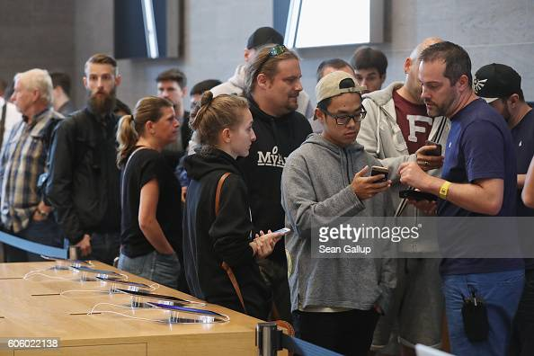 Customers who had preordered the Apple iPhone 7 wait to purchase it on the first day of sales of the new phone at the Berlin Apple store on September...