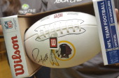 Customers win a signed football during a raffle during the Xbox One Gaming Tournament at the Microsoft store at Tyson's Corner on November 23 2013 in...