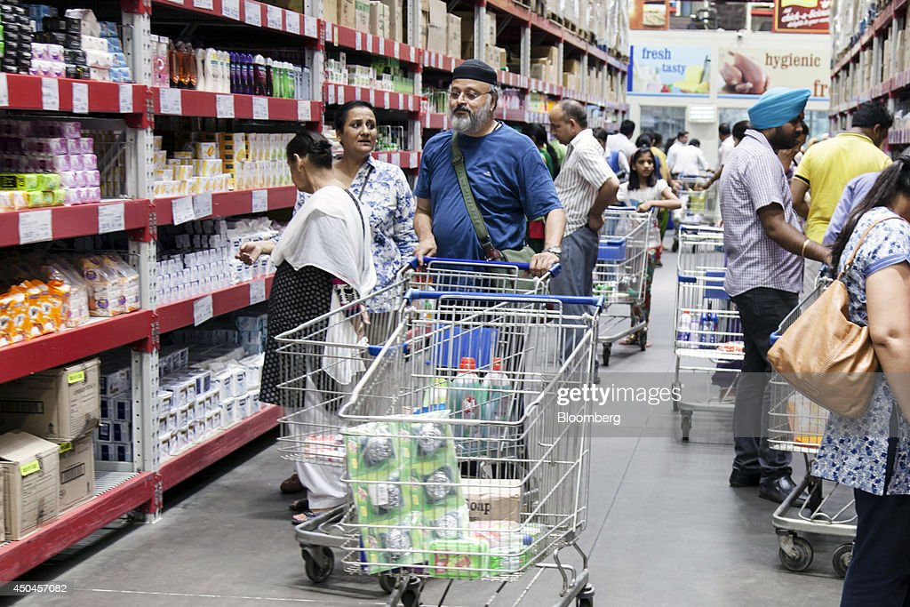 Customers with shopping carts browse personal-care items at a Walmart India Pvt. Best Price Modern Wholesale store in the town of Zirakpur on the outskirts of Chandigarh, Punjab, India, on Tuesday, June 10, 2014. India's consumer price index (CPI) figures and wholesale price inflation figures for May are scheduled for release on June 12 and 16 respectively. Photographer: Udit Kulshrestha/Bloomberg via Getty Images
