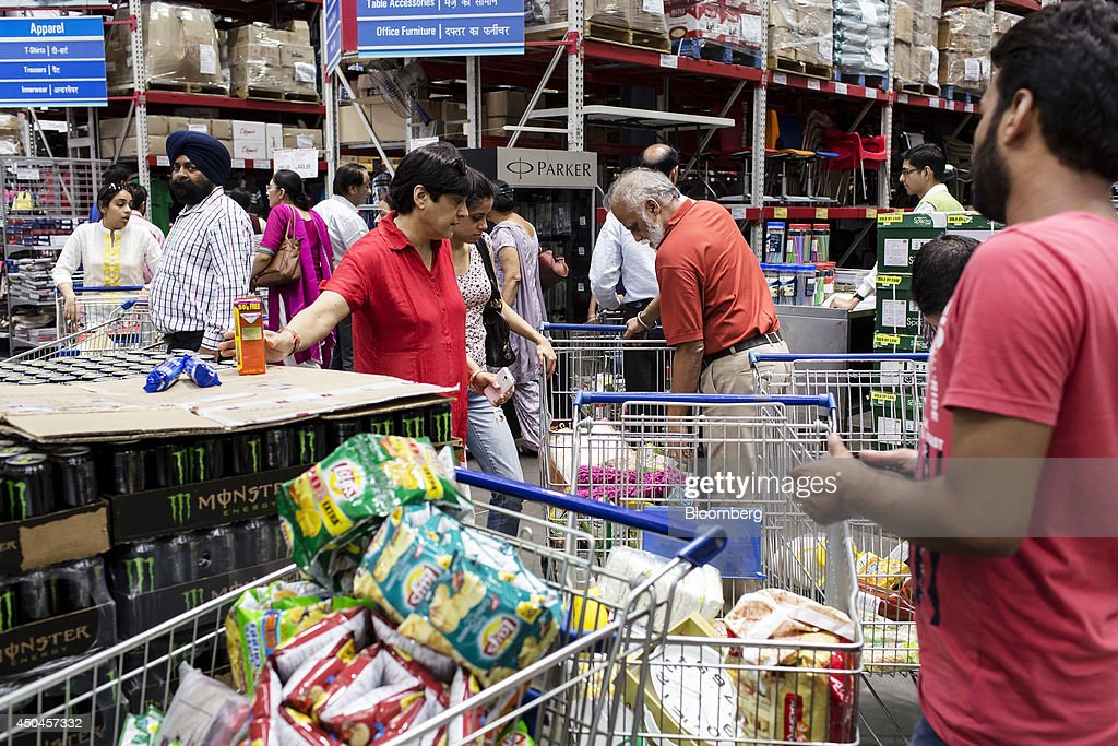 Customers with shopping carts wait in line at the checkout counter inside a Walmart India Pvt. Best Price Modern Wholesale store in the town of Zirakpur on the outskirts of Chandigarh, Punjab, India, on Tuesday, June 10, 2014. India's consumer price index (CPI) figures and wholesale price inflation figures for May are scheduled for release on June 12 and 16 respectively. Photographer: Udit Kulshrestha/Bloomberg via Getty Images