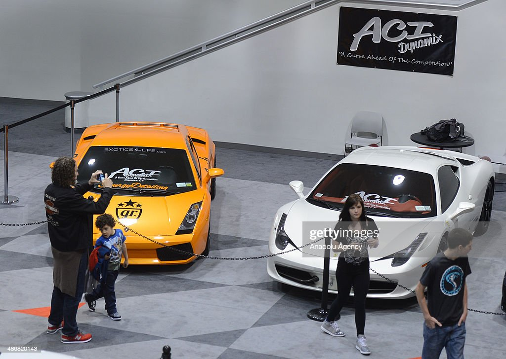 A customized Lamborghini and a Ferrari are seen during the 2014 New York International Auto Show at the Jacob Javits Center New York, United States on April 25, 2014.