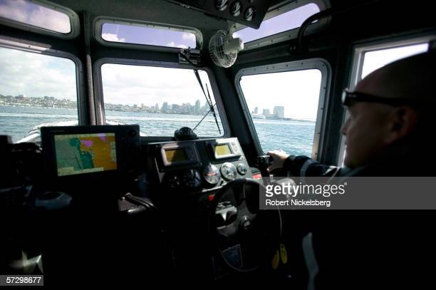 Customs and Border Patrol agents of the Marine Interdiction Unit return to their dock with the San Diego skyline on the horizon after searching for...