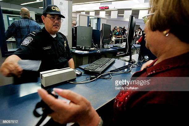 Customs and Border Protection agent checks a passport from a pedestrian at the San Ysidro Port of Entry June 1 2009 in San Ysidro California The...