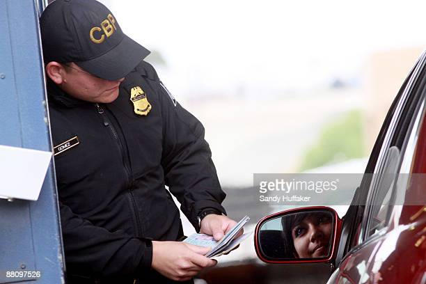 Customs and Border Protection agent Jesus Gomez checks a passport at the vehicle crossing at the San Ysidro Port of Entry June 1 2009 in San Ysidro...
