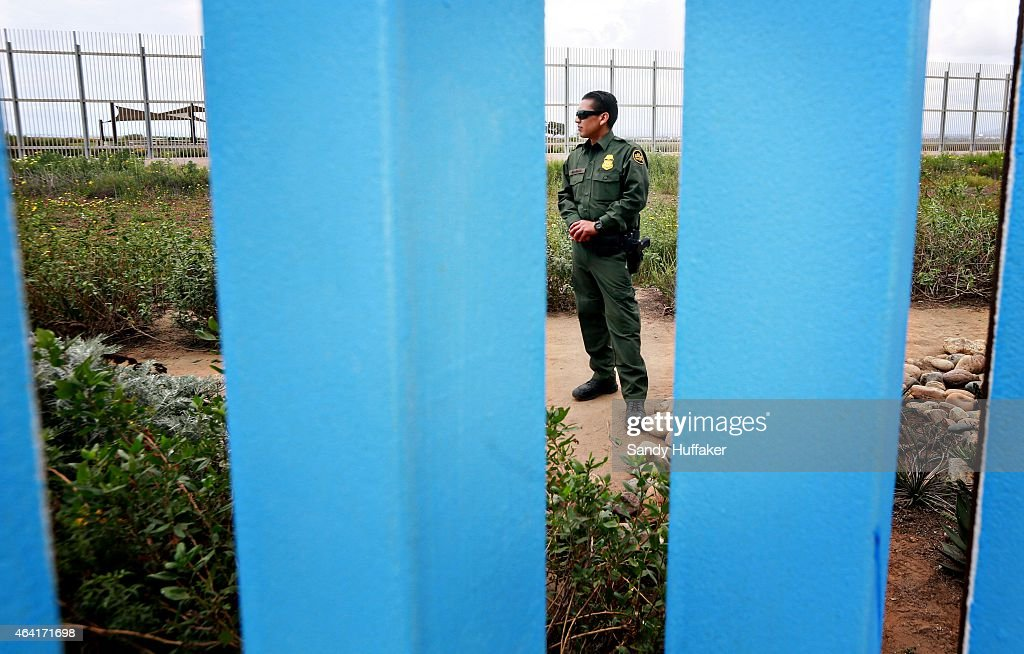 A Customs and Border Protection agent stands guard along the U.S.-Mexico border wall on February 22, 2015 in Tijuana, Mexico. Senior Republican senators said they expected Congress will avoid a shutdown over the Department of Homeland Security, which faces a partial shutdown on February 27 over a GOP push to roll back President Barack Obama's executive actions on immigration.