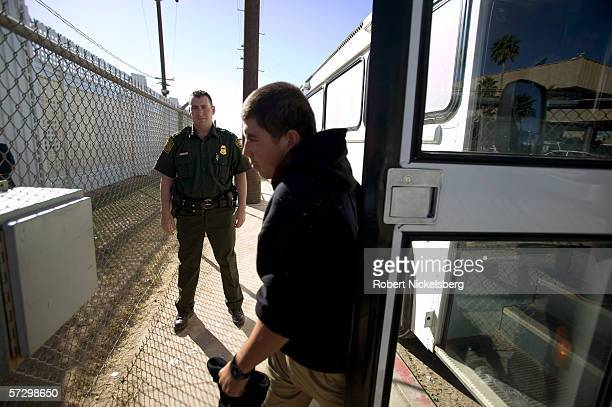 A US Customs and Border Protection agent watches as a Mexican national is deported from the US to Mexico at the CalexicoMexicali border crossing...