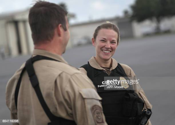 S Customs and Border Protection agent Zoe Cunningham talks with fellow pilots on March 15 2017 in McAllen Texas Cunningham is one of only a few women...