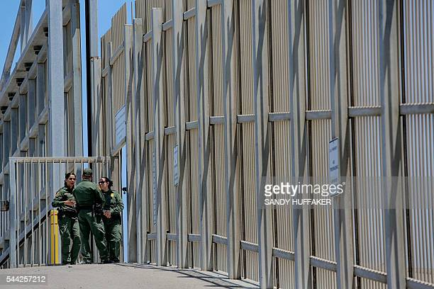 US Customs and Border Protection agents patrol the United StatesMexico Border wall at Friendship Park in San Ysidro California on Saturday July 2...