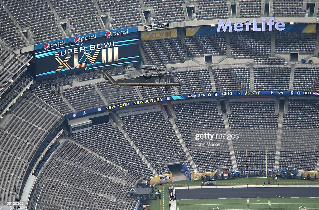 Customs and Border Protection Blackhawk helicopter flies past MetLife Stadium ahead of Super Bowl XLVIII on January 31 2014 in East Rutherford New...
